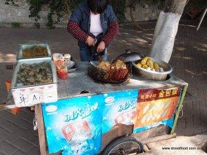 Sleeve protectors chinese street food at gulangyu island xiamen 25-12-2011 3-19-40 PM